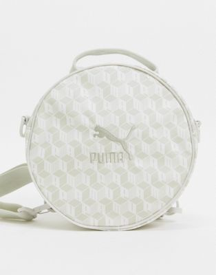 Puma unisex all over print round backpack in white | ASOS